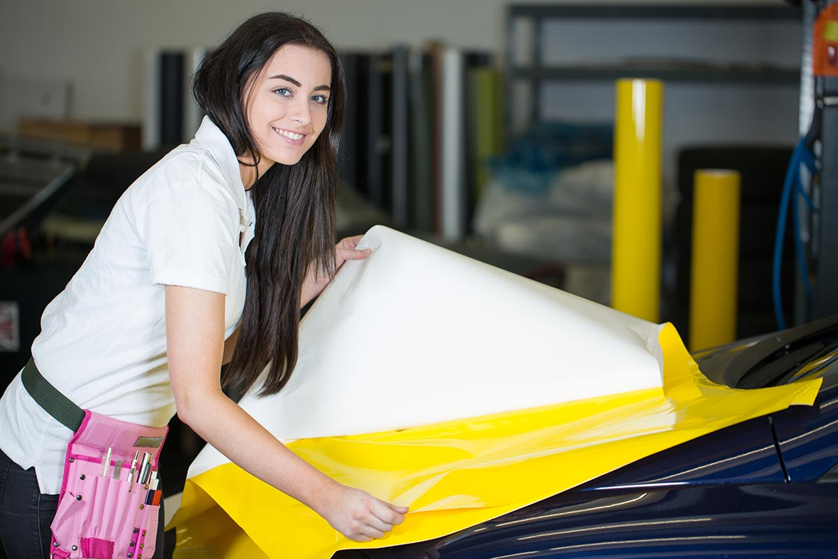 Bigstock Car Wrapper Preparing Foil To  64148365